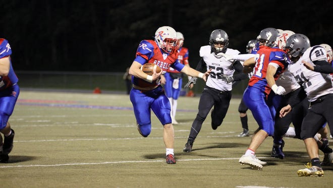 Roncalli running back Patrick McManama looks for space in the Rebels' sectional win over Northview.
