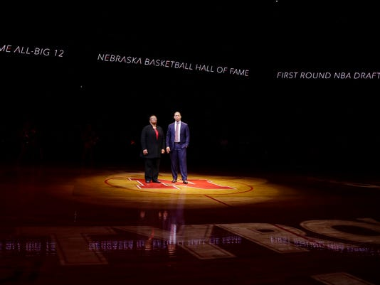 Cleveland Cavaliers coach Tyronn Lue stands with his mother Kim Lue during a ceremony to have his jersey retired in Lincoln, Neb., Thursday, Feb. 2, 2017. Tyronn played for Nebraska from 1995 to 1998 and was a two-time All-Big 12 selection. (AP Photo/Nati Harnik)
