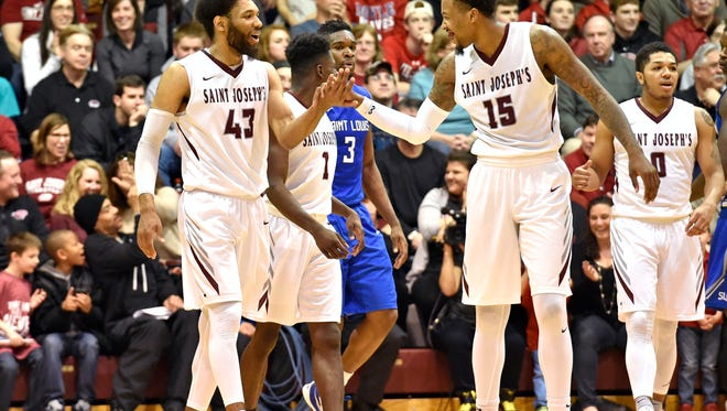 Saint Joseph's Hawks forward DeAndre Bembry (43) celebrates with  forward Isaiah Miles (15)  against the Saint Louis Billikens during the second half at Michael J. Hagan Arena.