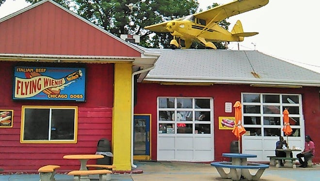 A full-size Piper airplane on the roof makes The Flying Wienie a funky area restaurant that is hard to miss.