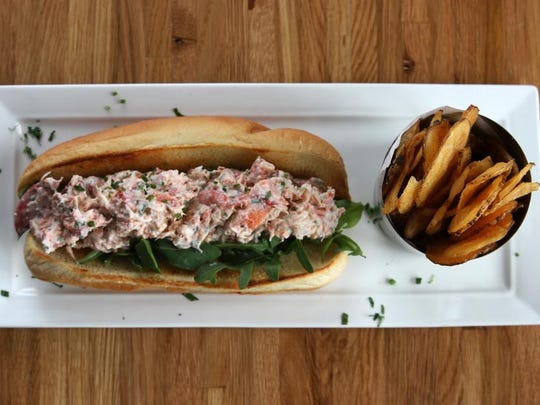 The lobster roll at Reef & Barrel in Manasquan is made with chive lemon mayo and served on a soft, buttered roll.