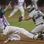 Lake Monsters' #14 beats the tag at home plate from Yankees' catcher Alvaro Noriega during their 9-4 win at home at Centennial Field in Burlington Wednesday night.