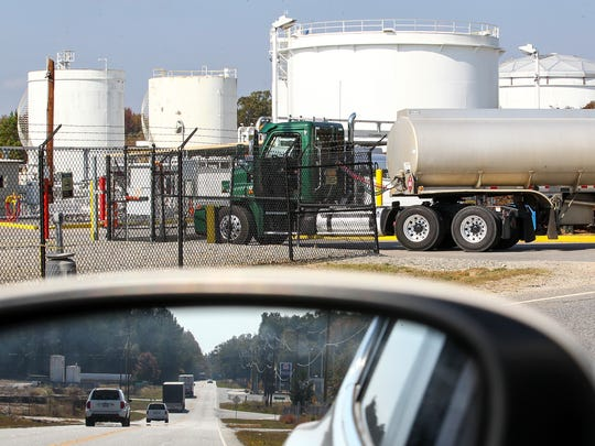 Gas tankers enter the Buckeye terminal Tuesday while cars, seen in the mirror, drive into Belton on S.C. 20.