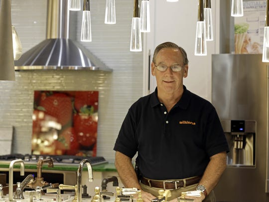 Ken Wertz, president of Wilkinson Supply, poses for a picture in the company's showroom that sells kitchen, bathroom, plumbing and decorative items, in Raleigh, N.C. Small businesses such as Wilkinson Supply are preparing for an impending change in overtime.