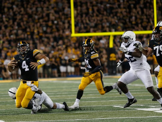 Iowa quarterback Nate Stanley gets sacked during the Hawkeyes' game against No. 4 Penn State at Kinnick Stadium on Saturday, Sept. 23, 2017.