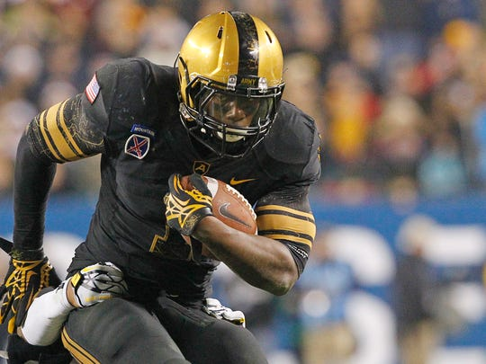 Army running back Raymond Maples carries the ball against Navy during a game in Philadelphia in December 2012.