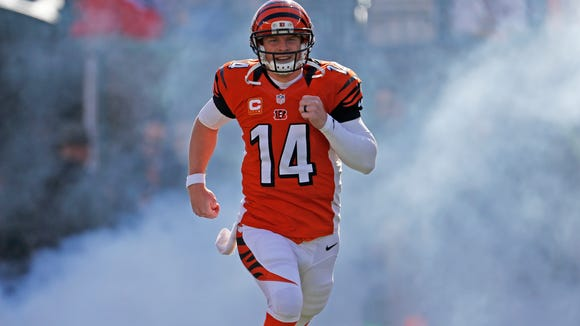 Bengals quarterback Andy Dalton runs onto the field before Sunday's game against the Jaguars.