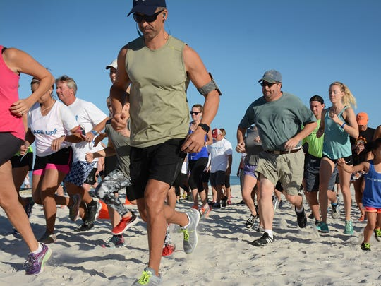 Runners take off for a two-mile run along the beach.