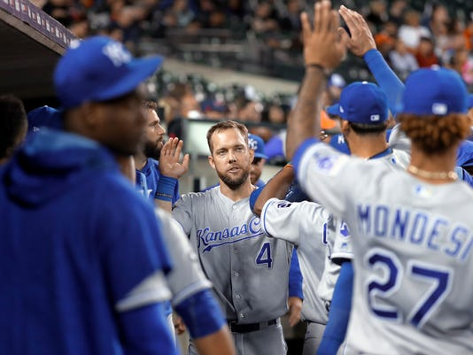 Kansas City Royals' Alex Gordon (4) celebrates scoring on a Whit Merrifield double against the Detroit Tigers in the seventh inning of a baseball game in Detroit, Wednesday, Sept. 6, 2017. (AP Photo/Paul Sancya)