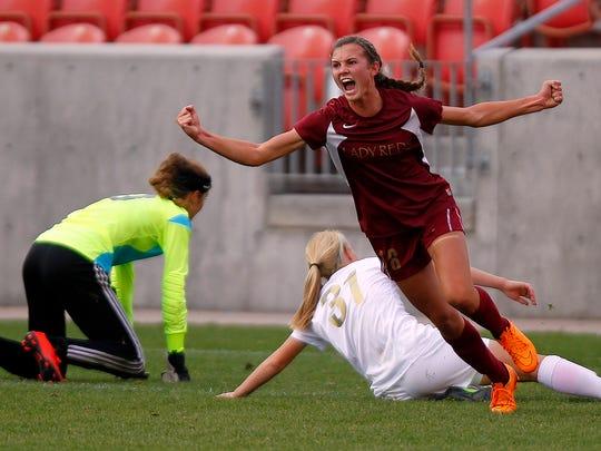 Cedar's Morgan Myers celebrates scoring a goal against Logan in the 3A girls high school soccer championship at Rio Tinto Stadium on Saturday.
