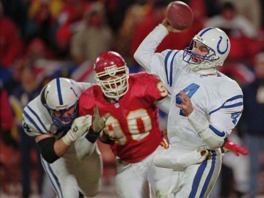 Colts quarterback Jim Harbaugh attempts a pass against