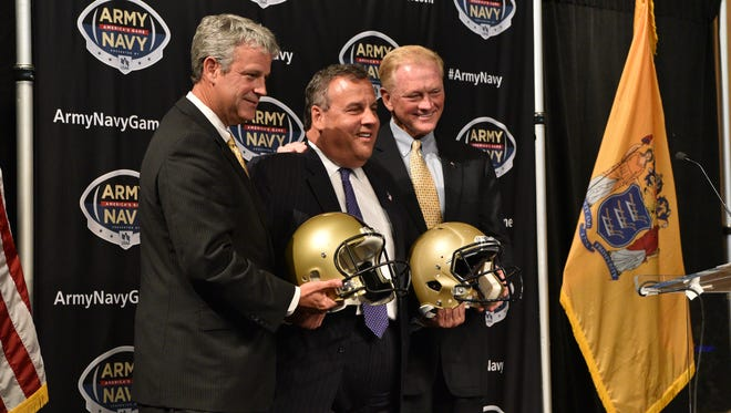 New Jersey Governor Chris Christie poses for a photo with Boo Corrigan, Athletic Director, U.S. Military Academy, left and Chet Gladchuk, Athletic Director, U.S. Naval Academy after announcing an incoming Army-Navy Game for 2021 at the Metlife Stadium in East Rutherford. Photo: Marko Georgiev/NorthJersey.com