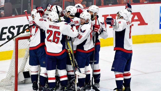 The Washington Capitals celebrate after advancing to the second round of the Stanley Cup Playoffs. The beat the Philadelphia Flyers 1-0 in Game 6.