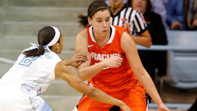 Jan 30, 2014; Chapel Hill, NC, USA; Syracuse Orange guard Brianna Butler (right) battles for the ball with North Carolina Tarheels guard Latifah Colmeman at Carmichael Auditorium.