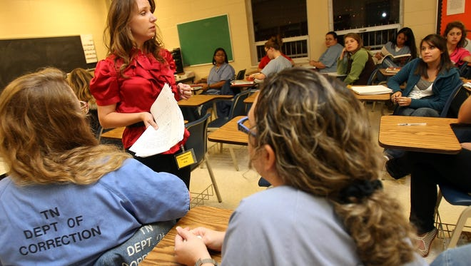 Lipscomb University professor Laura Lake Smith teaches prison inmates in this file photo from 2009.