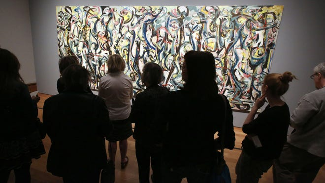 "Members of the media preview Jackson Pollock's ""Mural""  on March 10, 2014 at the J. Paul Getty Museum in Los Angeles.  Monday, March 10, 2014."