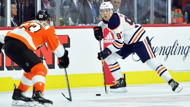 Shayne Gostisbehere, left, made some noticeable defensive stops on Connor McDavid, right, in Saturday's game.