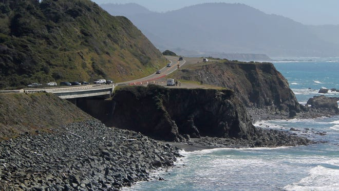 Investigators with the California Highway Patrol work at the scene where a couple and several of their children plunged in their SUV off Highway 1, Wednesday, March 28, 2018, near Fort Bragg, Calif.