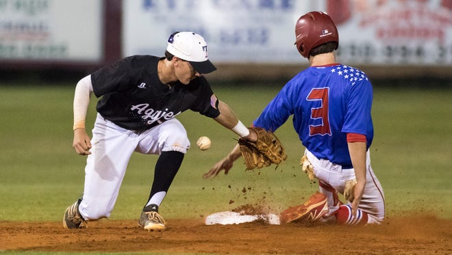 JC Peacher (3) safely slides into second base as Mason Land (9) can't hang onto the throw during the District 1-7A baseball championship game between Pace and Tate high schools at Pace High School on Thursday, May 3, 2018.