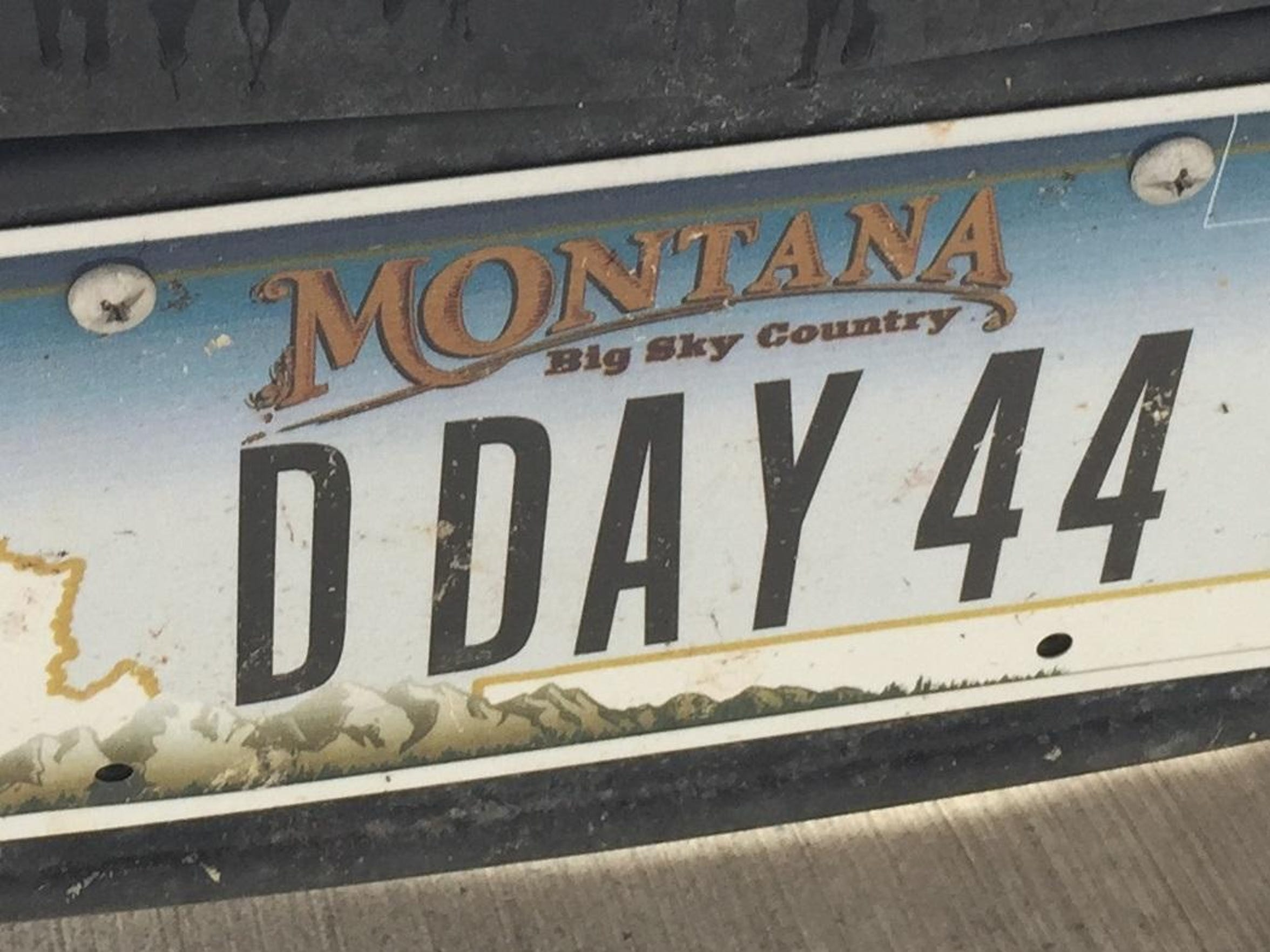 """Bud Olson's license plates reads """"D Day 44,"""" memorializing"""