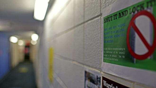 Signs warning of an unclothed man are pasted in the second floor of Missouri State University's Hammons House dormitory, after several incidents of an unknown male exposing himself to people inside the dorm.