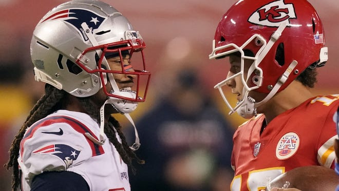 New England Patriots cornerback Stephon Gilmore (left) talks with Kansas City Chiefs quarterback Patrick Mahomes after a game on Oct. 5 in Kansas City. Gilmore later found out he had the coronavirus.
