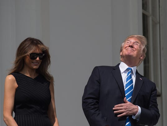 US-SOLAR-ECLIPSE-TRUMP
