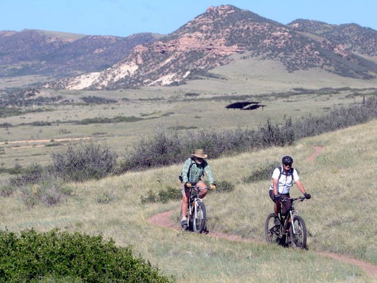 Richard Hohm, left, and John Ball, both of Fort Collins, ride their mountain bikes at Soapstone Prairie Natural Area on Thursday July 26, 2012.
