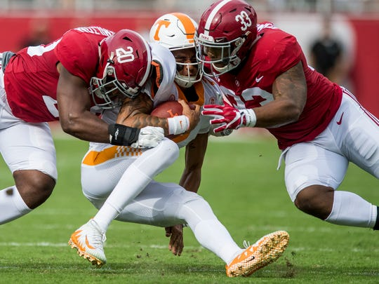 Alabama linebacker Shaun Dion Hamilton (20) and linebacker Anfernee Jennings (33) tackle Tennessee quarterback Jarrett Guarantano (2) in first half action at Bryant-Denny Stadium in Tuscaloosa, Ala. on Saturday October 21, 2017. (Mickey Welsh / Montgomery Advertiser)