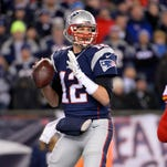 New England Patriots quarterback Tom Brady (12) throws a pass during the second quarter against the Kansas City Chiefs in the AFC Divisional round playoff game at Gillette Stadium.