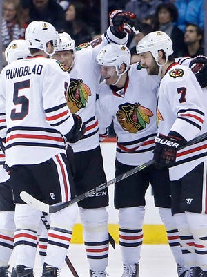 The Chicago Blackhawks celebrate a goal during a 4-2 win against the Colorado Avalanche.