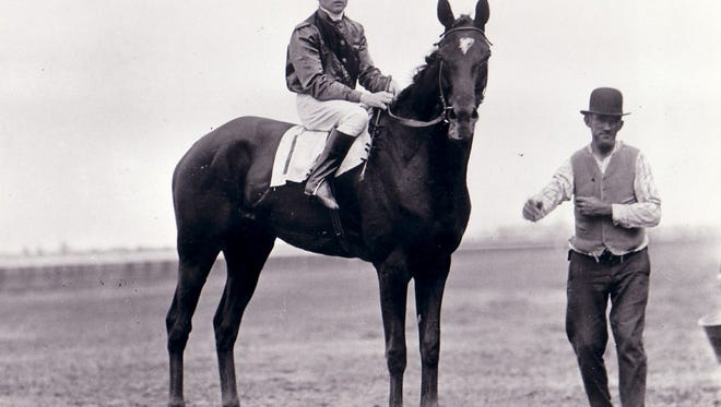 Exterminator with his trainer, Henry McDaniel, right, around 1920.
