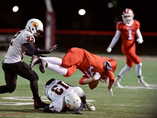 East Pennsboro's Daiquaan Everett trips up Susquehannock's Daniel Clapp in the first half of a PIAA District 3 first-round game Friday, Nov. 10, 2017, at Susquehannock. Susquehannock lost 45-14 to East Pennsboro in the Warriors' first playoff appearance since 2006, ending their first winning season since 2007.
