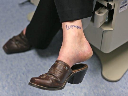 Laura Beth Buchleiter talks about her gender reassignment surgery, Friday, June 8, 2018.  She had the surgery at IU Health's Gender Affirmation Surgery Program.  On her ankle is a tattoo that says Unru;ned.  It signifies that her body is not ruined by gender reassignment.  The semicolon stands for the hope for the reduction of suicide.
