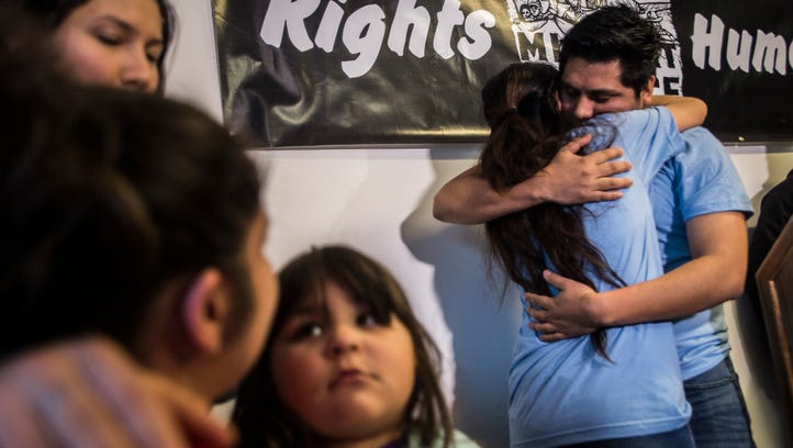 Right, Zully Palacios is embraced by Enrique Balcazar at a news conference at the Vermont Workers Center in Burlington, Vt., on Tuesday night, March 28, 2017, after they were released on bail. Both were arrested by ICE along with Alex Carillo who remains in federal detention.