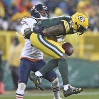 Green Bay Packers wide receiver Davante Adams (17) can't hang onto a pass against Chicago Bears cornerback Tracy Porter (21)at Lambeau Field November 26, 2015.