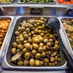 What might a shopper find at the Queen Creek Olive Mill? Olives, of course, and plenty of oil.