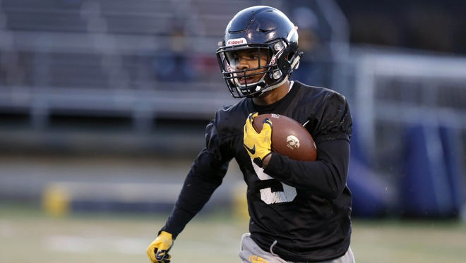 Iowa wide receiver Jerminic Smith runs the ball Friday, April 8, 2016, during the Haweye's open practice at Valley Stadium in West Des Moines.