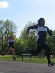 Beyonca Allen and Anna Wheatley race down the track.