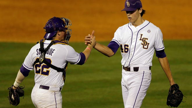LSU's Kade Scivicque celebrates with Parker Bugg (46) after defeating Auburn 9-8 in a game at the Southeastern Conference college baseball tournament Wednesday.