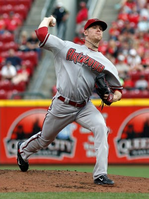 Diamondbacks starting pitcher Chase Anderson throws against the Cincinnati Reds in the first inning at Great American Ball Park.