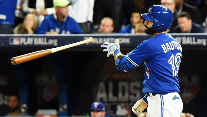 Oct 14, 2015; Toronto, Ontario, CAN; Toronto Blue Jays right fielder Jose Bautista (19) reacts after hitting a three run home run during the seventh inning against the Texas Rangers in game five of the ALDS at Rogers Centre. Mandatory Credit: Dan Hamilton-USA TODAY Sports