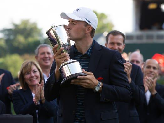 Jordan Spieth kisses the championship trophy after