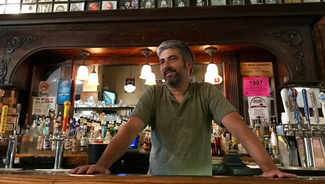 Vaughn Derderian relaxes behind the bar at the Anchor Bar on Monday, July 30, 2018. The bar was buzzing with activity as people learned the Derderians announced that they would be selling the legendary establishment after 59 years to Detroit developer Zaid Elia.