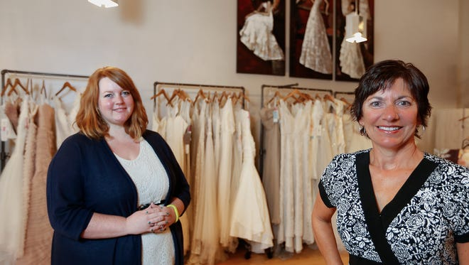 Courteney Ferrin, owner of Belles and Lace Bridal, left, and her mother-in-law, Sue Ferrin who is a consultant in their Great Falls shop.