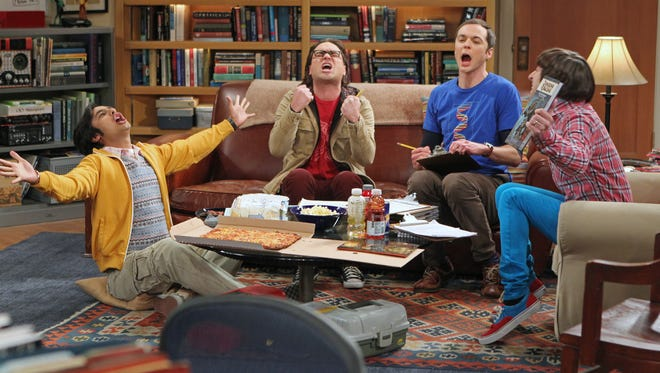 """This publicity image released by CBS shows, from left,  Kunal Nayyar, Johnny Galecki, Jim Parsons and Simon Helberg in a scene from """"The Big Bang Theory."""""""