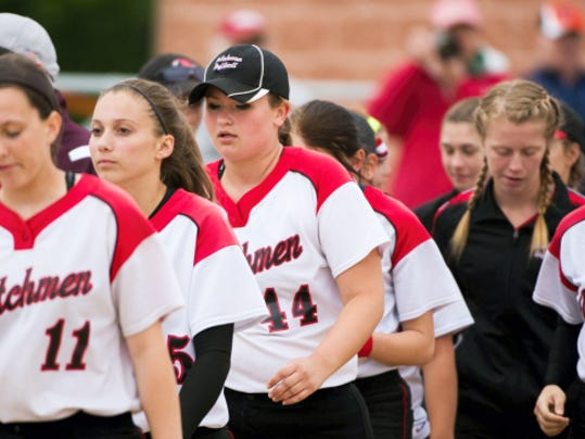 The Annville-Cleona girls softball team walks off the field in disappointment after Thursday's season-ending loss.