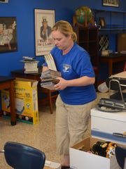 Alexandria Middle Magnet School teacher Tina Simmons sets up her seventh-grade American history and law classroom on Tuesday.