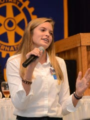 Pineville High student Elizabeth Hamblin, 16, talked to Rotary members about the camp she attended with 19 other Rapides students.