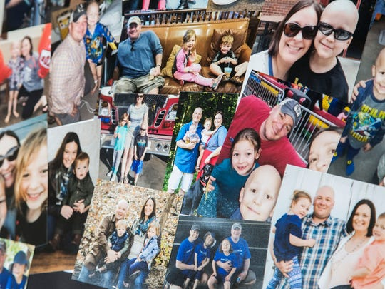 Photos of Garrett Matthias and his family are set-out